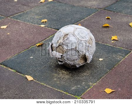 Old, Tattered Soccer Ball On A Street Tile