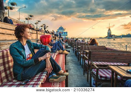 Istanbul Turkey: People are spending leasure time at cafe and meeting sunset with view of Maiden's tower in Uskudar on October 3 2017