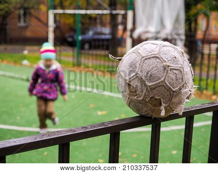 Old, Tattered Soccer Ball At The Playground