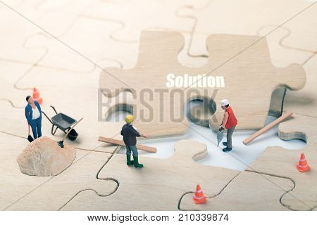 mission complete and problem solution concept. construction workers on jigsaw puzzle