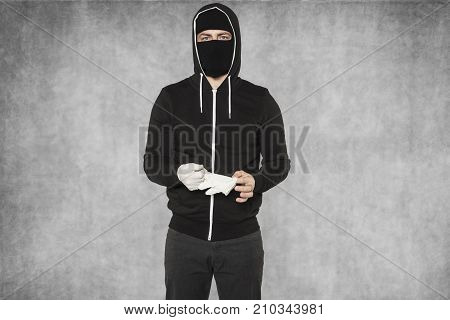 Masked Man Removes Gloves