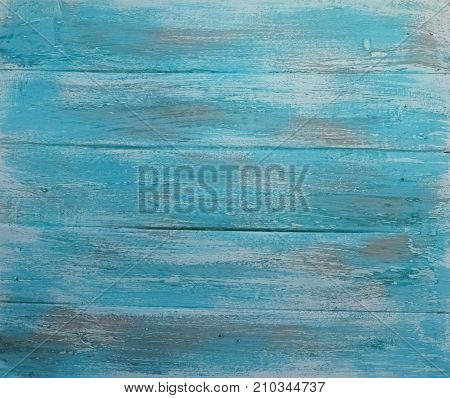 Wooden background. Texture, the surface of the old boards from natural wood with different shades of white, brown, blue, turquoise color. The top view. Close-up. The stock photos.