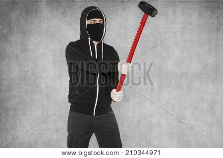 The Masked Stranger Strikes A Large Hammer