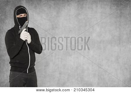 Thief With A Pistol In His Hands, Next To Copy Space
