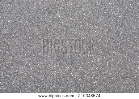 Silver (gray) glitter background. Sparkle texture. Abstract twinkle background for New Years or Christmas holiday