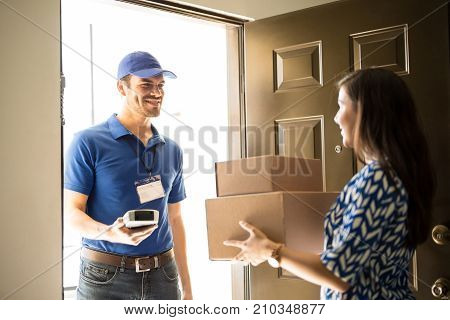 Delivery Man Getting A Signature