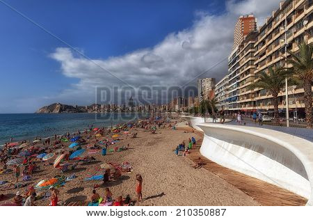 Editorial Benidorm, Spain - October 8, 2017: Holiday makers on Poniente Beach in Benidorm, the popular Spanish holiday resort on the eastern coast of Spain, part of the Costa Blanca