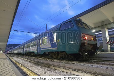 train at the railway station in the evening