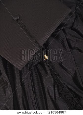 a graduation cap and gown background with nobody.