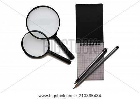 office on a white background. Notepad pen and magnifiert. Business and financial concept. view from above
