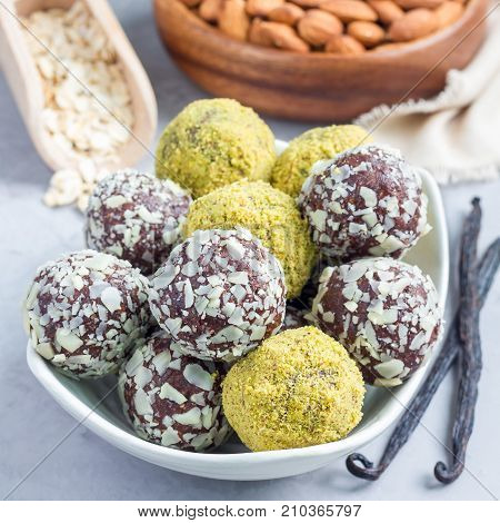 Healthy homemade paleo chocolate energy balls on plate square format