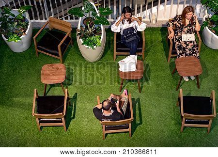 NONTHABURI THAILAND - OCTOBER 08: Shoppers take a break in the resting area in CentralPlaza Westgate in Nonthaburi on October 08 2017.