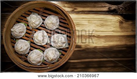 Delicious Taiwanese Styled Feshly Steamed Xiaolongbao in Bamboo Steamer