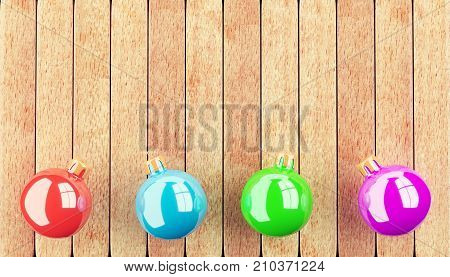 Four christmas balls on wooden table. 3d rendering