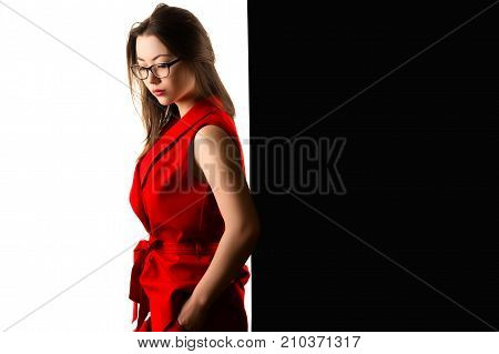 pensive charming business woman in red suit