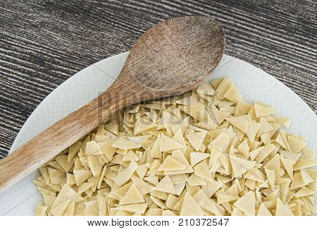 homemade triangular cut dough granules in a plate. Turkish style home made triangular cut dough granules