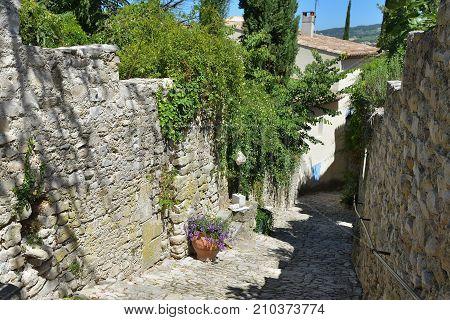 France Provence. Narrow street in the medieval village Vaison la Romaine