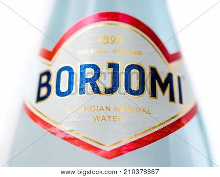 MOSCOW, RUSSIA - OCTOBER 23, 2017: Glass bottle of mineral water Borjomi. Macro shot with Shallow DOF. Natural Mineral water of Borjomi is one of the most famous products of Georgia.