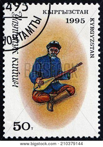 KYRGYZSTAN - CIRCA 1995: a stamp printed in the Kyrgyzstan shows Man in Traditional Kyrgyz Costume with a Mandolin circa 1995