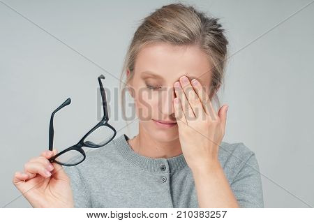 Tired Woman With Eyeglasses, Covering Eye With Hands