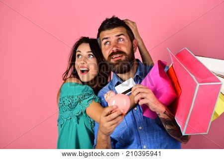 Guy With Beard And Girl With Surprised Faces Do Shopping.