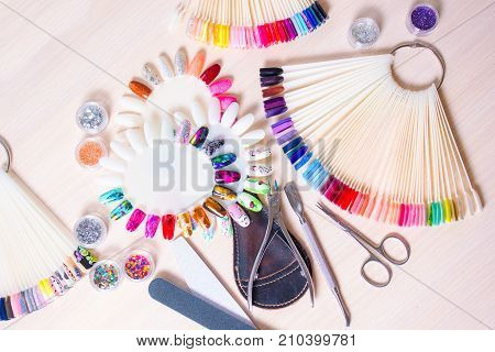 manicurist work with manicure set for hands care wooden background top view poster