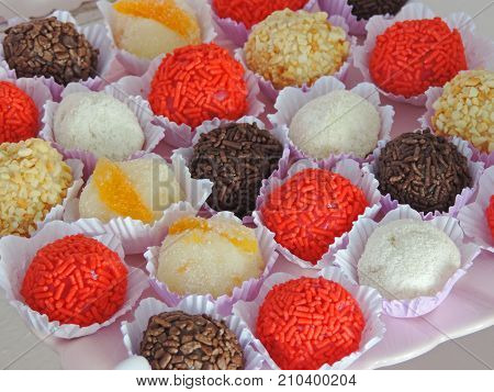 Sweet colored granules and sugar candies in a party