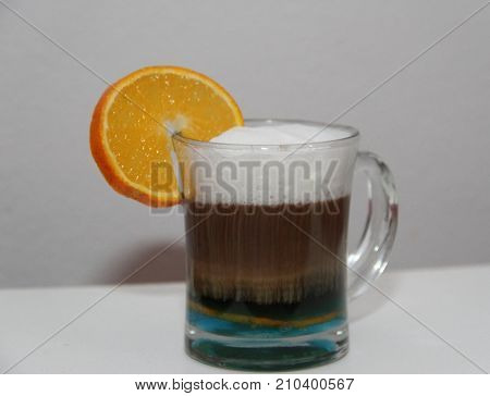 cafe with curacao and orange liqueur on white background