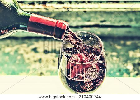 Pouring Wine. Red Wine In A Glass. Sommelier Wine Into The Glass On A Blue Background Old.