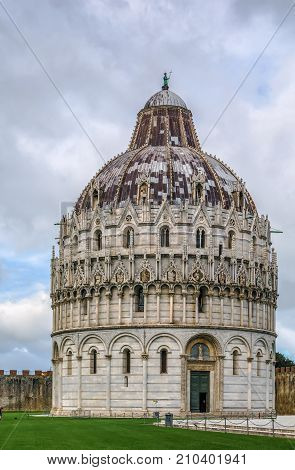 Pisa Baptistry stand on Piazza dei Miracoli in Pisa.The round Romanesque building was begun in the mid 12th century. It is the largest baptistery in Italy