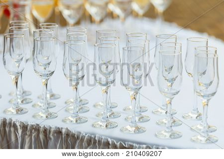 Glasses in a row at a buffet table
