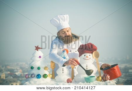 Man In Chef Hat Ladling Soup On Winter Day