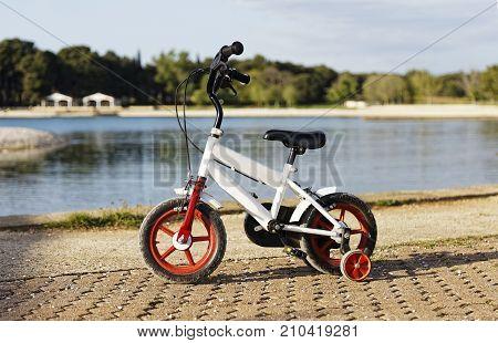 children's bike standing on the promenade near the sea