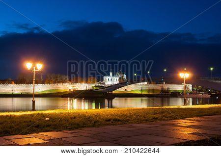 Veliky Novgorod Russia. St Sophia cathedral Kremlin walls pedestrian bridge across the Volkhov river in Veliky Novgorod, Russia. Night city landscape of Veliky Novgorod Russia