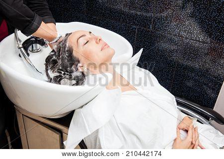 White Woman Getting A Hair Wash Procedure In A Beauty Salon