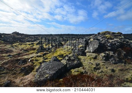 A lava field on the Snaefellsnes Peninsula in Iceland with volcanic rocks poster