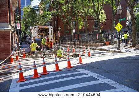 BOSTON MA, USA - OCTOBER 4, 2017: Utility crew working in Beacon Hill. Urban scene. Repair of communications in Boston, Massachusetts, USA