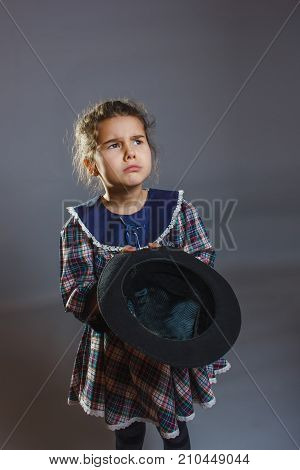 girl with hat in hand asking coins