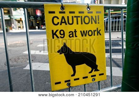 K9 at work sign at a police barricade.