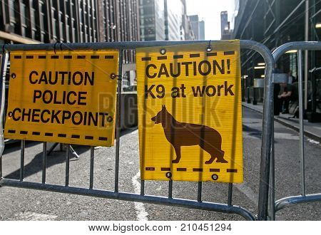 Police Checkpoint K9 at work signs on a barricade.