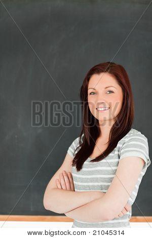 Portrait Of A Cute Woman Standing In Front Of A Blackboard