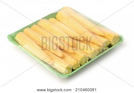 Packed fresh baby corn isolated on white
