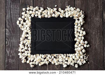 Movie clapper with fresh popcorn