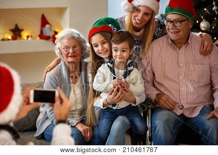 Family with grandparents take photo together for Christmas