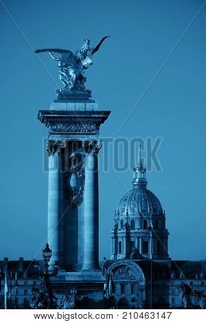 Alexandre III bridge and Napolean's tomb in Paris, France.