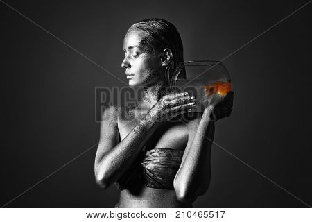 Beautiful young woman with amazing bodyart as Pisces on grey background. Zodiac signs concept