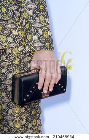 Erin Bowman with a black clutch purse at the taping of