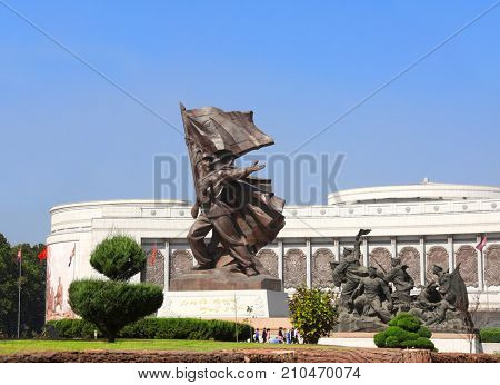NORTH KOREA, PYONGYANG - SEPTEMBER 20, 2017: Museum of Victory. Statue of a soldier with a flag at the entrance to the Victorious Fatherland Liberation War Museum. North Korea (DPRK)