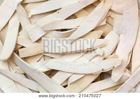 Selective focus of white dried Chinese Yam, Chinese potato, Shan Yao, cinnamon-vine, used as traditional Chinese medicine (Rhizoma Dioscoreae)