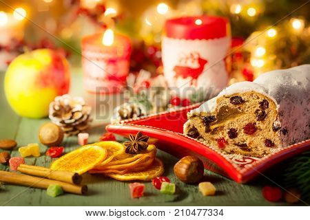 Traditional  Christmas cake Stollen with marzipan,dried fruit and icing sugar.